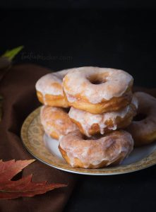Soft, fluffy delicious homemade yeast doughnuts are dipped in a vanilla glaze to fulfill all your doughnut cravings. | Homemade doughnut recipe | The Teatime Baker | glazed doughnuts #homemadeyeastdonuts
