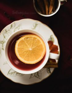 Cranberry Spice Tea is fresh & bright with a tart cranberry base topped with orange juice and spiced with cinnamon and cloves. It's the holidays in a drink! | The Teatime Baker | Winter Tea | Holiday Drinks | Thanksgiving | #cranberryspicetea #holidaytea