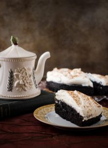 Easy Dark Chocolate Cake is simple and delicious. Topped with a generous helping of whipped cream and sprinkled with cinnamon it's sure to be a favorite! | One bowl chocolate cake | The Teatime Baker | Holiday Baking | Dark Chocolate Cake | #easydarkchocolatecake #simpleholidaydessert