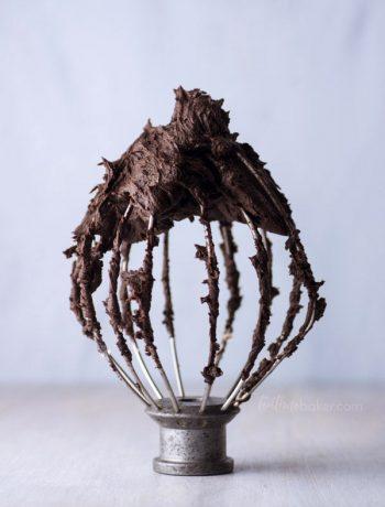 Dark Chocolate Buttercream swirling on a mixer whisk