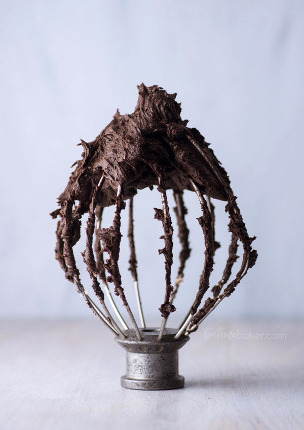 Dark Chocolate Buttercream swirling on a mixer whisk