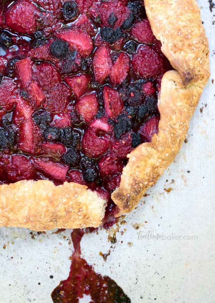 Red & Black Raspberries and strawberries create a beautiful juicy filling in this Triple Berry Galette | Berry Recipes