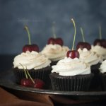 Deep chocolate cupcakes topped with whipped cream and a cherry | Dessert Recipes | Cupcake Recipes