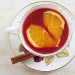 Cranberry Spice Tea is fresh & bright with a tart cranberry base topped with orange juice and spiced with cinnamon and cloves. It's the holidays in a drink!   The Teatime Baker   Winter Tea   Holiday Drinks   Thanksgiving   #cranberryspicetea #holidaytea