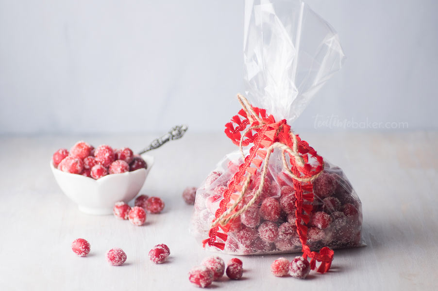 Make something different for holiday parties this year - Boozy Sugared Cranberries! Sweet and tart with a burst of flavor they are hard to stop eating. | Holiday Parties | The Teatime Baker | Cocktails | #boozysugaredcranberries #holidaytreats #newyearseve