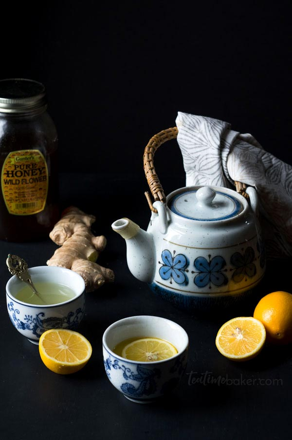 Blue and gray teapot with two small glasses of lemon ginger tea