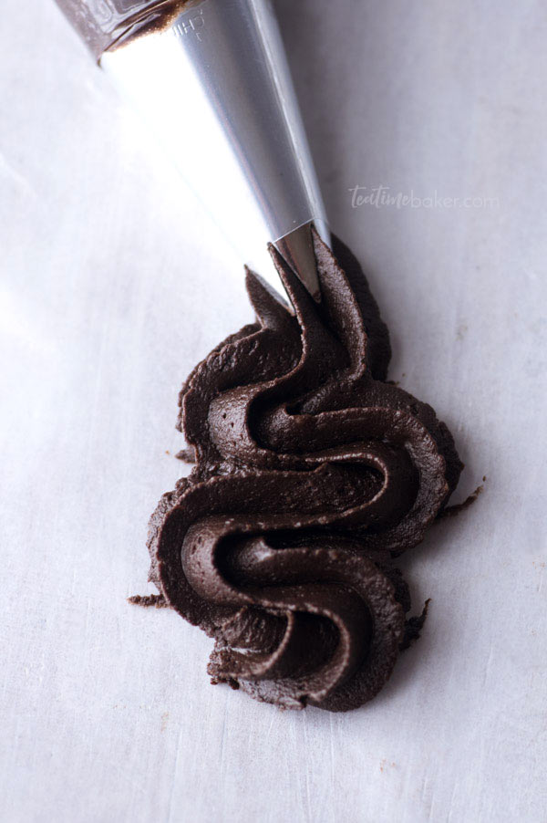 Dark Chocolate Buttercream being piped into a swirl