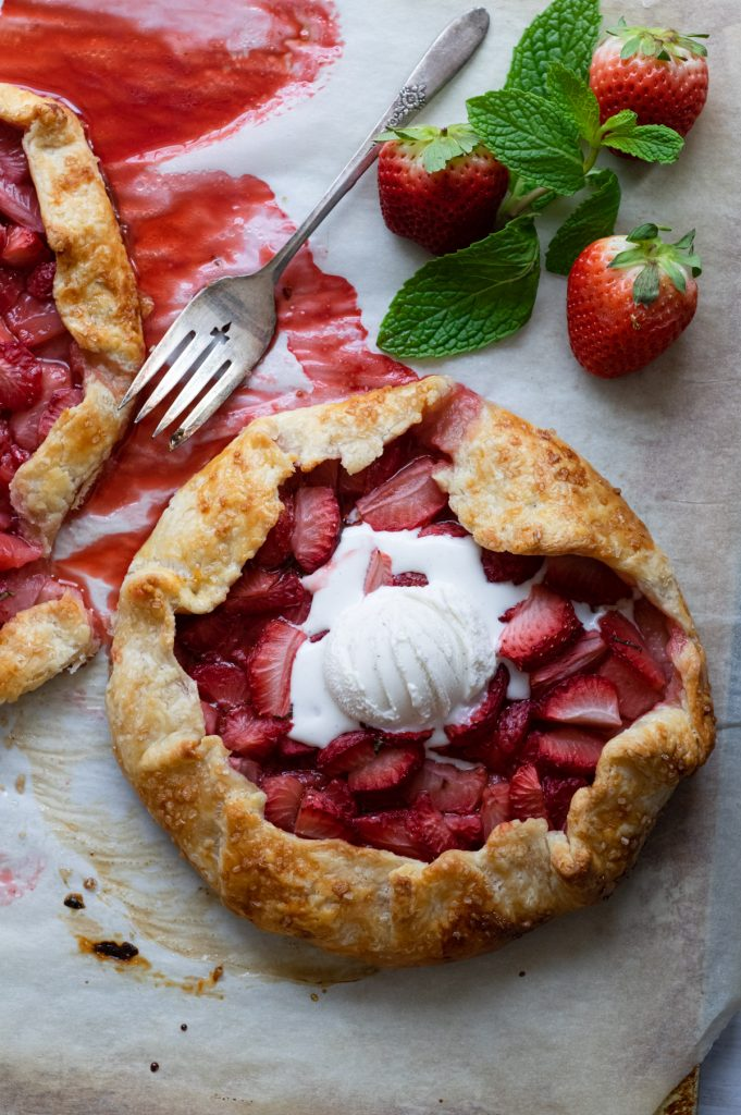 Rustic strawberry galette with fresh mint and ice cream